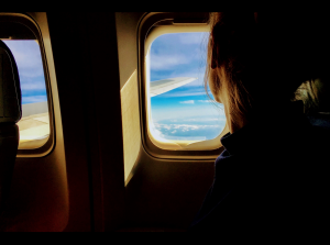 Person looking out of airplane window